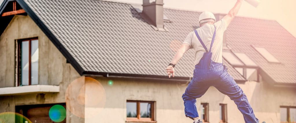 home energy audit technician jumping for joy